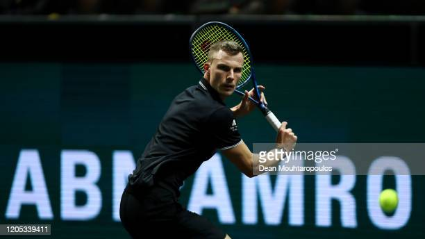Marton Fucsovics of Hungary returns a backhand to Roberto Bautista Agut of Spain during Day 3 of the ABN AMRO World Tennis Tournament at Rotterdam...