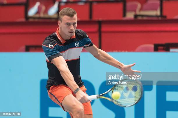 Marton Fucsovics of Hungary returns a ball during the round of 8 match against Mikhail Kukushkin of Kazakhstan on day five of the Erste Bank Open 500...