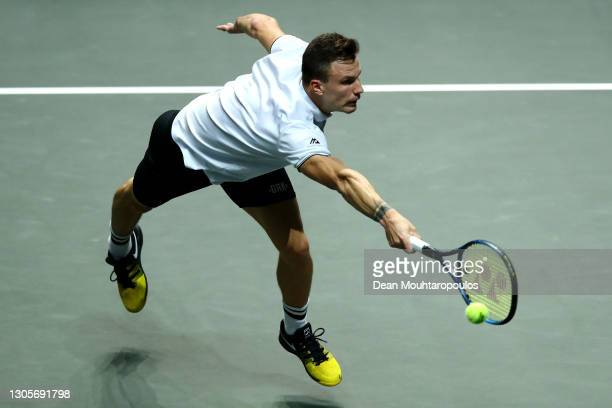 Marton Fucsovics of Hungary returns a forehand in his match against Borna Coric of Croatia during Day 6 of the 48th ABN AMRO World Tennis Tournament...