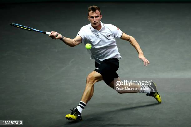 Marton Fucsovics of Hungary returns a forehand in the Mens Finals match against Andrey Rublev of Russia during Day 7 of the 48th ABN AMRO World...