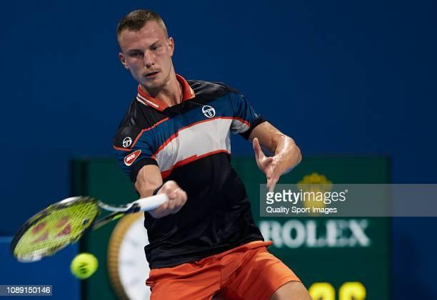 Marton Fucsovics of Hungary returns a shot during his match against Novak Djokovic of Serbia during day three of the ATP Qatar ExxonMobil Open at...