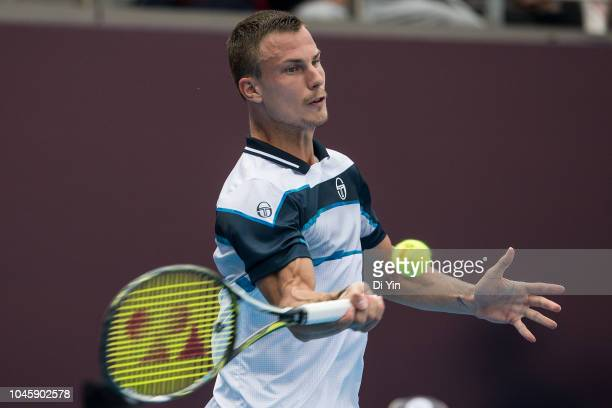 Marton Fucsovics of Hungary returns the ball during his men's 1/4 final match against Fabio Fognini of Italy of 2018 China Open at the China National...