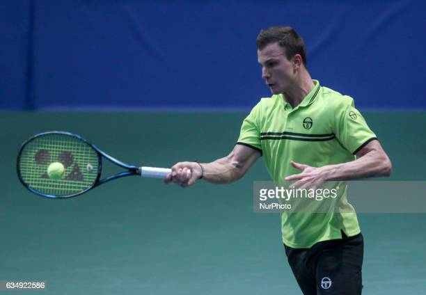 Marton Fucsovics of Hungary returns the ball in the final at Hungarian Challenger Open 2017 at BOK Hall on February 12 2017 in Budapest Hungary