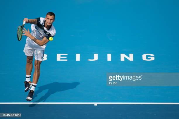 Marton Fucsovics of Hungary serves during his men's 1/4 final match against Fabio Fognini of Italy of 2018 China Open at the China National Tennis...