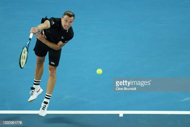 Marton Fucsovics of Hungary serves during his Men's Singles fourth round match against Roger Federer of Switzerland on day seven of the 2020...