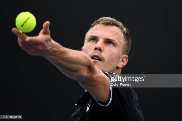 Marton Fucsovics of Hungary serves during his Men's Singles third round match against Tommy Paul of the United States on day five of the 2020...