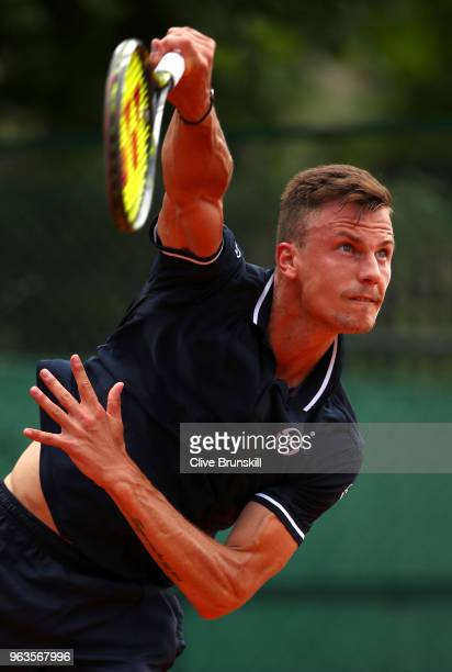Marton Fucsovics of Hungary serves during the mens singles first round match against Vasek Pospisil of Canada during day three of the 2018 French...