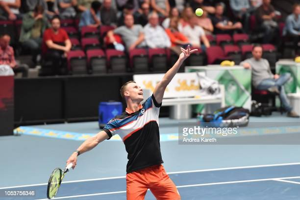 Marton Fucsovics of Hungary serves during the round of 8 match against Mikhail Kukushkin of Kazakhstan on day five of the Erste Bank Open 500 at...