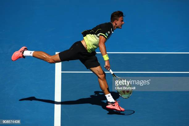 Marton Fucsovics of Hungary serves in his fourth round match against Roger Federer of Switzerland on day eight of the 2018 Australian Open at...