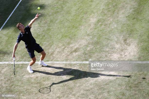 Marton Fucsovics of Hungary serves the ball to Milos Raonic of Canada during day 4 of the Mercedes Cup at Tennisclub Weissenhof on June 14 2018 in...