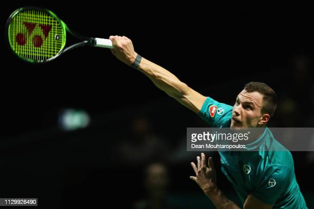 Marton Fucsovics of Hungary serves to Kei Nishikori of Japan in their quarter final match during Day 5 of the ABN AMRO World Tennis Tournament at...