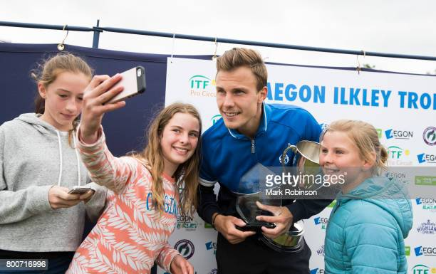 Marton Fucsovics of Hungary takes some selfies with fans after winning the men's singles final on June 25 2017 in Ilkley England