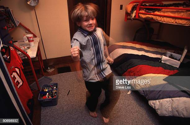 Marty 9yearold child diagnosed w attention deficit/hyperactivity disorder dancing around his room re controversy about prevalent use of Ritalin other...