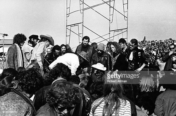 Marty Balin of the Jefferson Airplane is surrounded Hells Angels acting as both security and hoodlums For a while he was knocked unconscious by The...