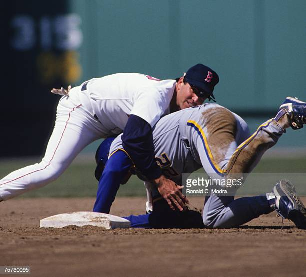 Marty Barrett of the Boston Red Sox fallling over Charlie O'Brien of the Milwaukee Brewers at second base on April 13 1990 in Fenway Park in Boston...