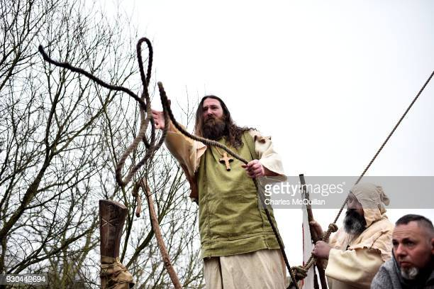 Marty Burns who plays Saint Patrick is brought to shore past Downpatrick cathedral as the reenactment of Saint Patrick's first landing in Ireland...