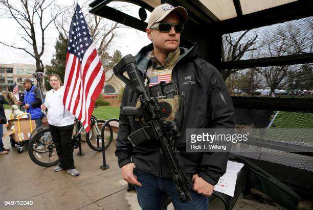 Marty Combs openly carries his AR-15 pistol at a pro gun rally on April 21, 2018 in Boulder, Colorado. The city of Boulder is considering enacting an...