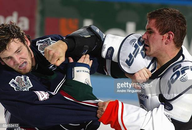 Marty Doyle of the Shawinigan Cataractes and David Starenky of the Gatineau Olympiques fight during the Quebec Major Junior Hockey game at...