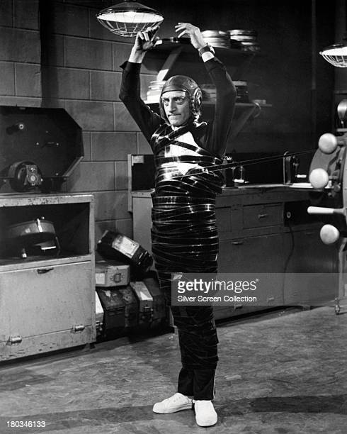 Marty Eggs played by English actor and comedian Marty Feldman wrapped in film stock in an editing room scene in 'Silent Movie' directed by Mel Brooks...