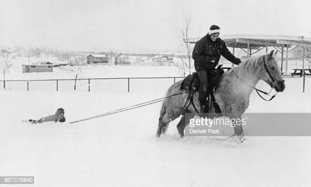 Marty Fairchild of 9761 W Florida Place Lakewood aboard Cindy pulls Robin Gear of 1340 Welch St Lakewood through the snow on her onehorse open sleigh...