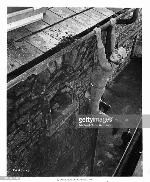 Marty Feldman hangs in there during the course of a daring jailbreak in a scene from the film 'The Last Remake Of Beau Geste' 1977