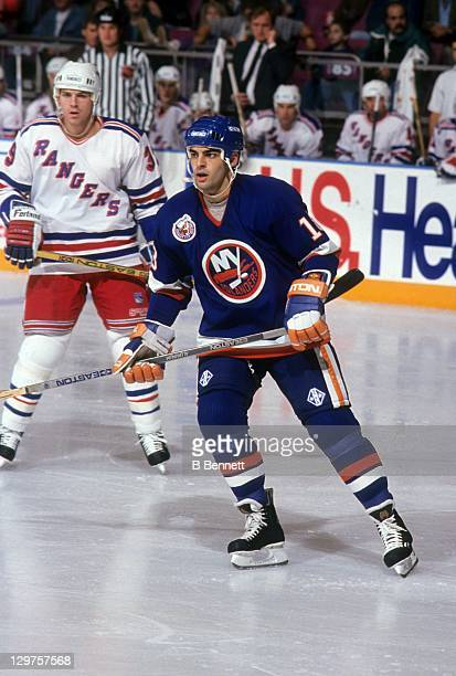 Marty McInnis of the New York Islanders skates on the ice during an NHL game against the New York Rangers circa 1993 at the Madison Square Garden in...