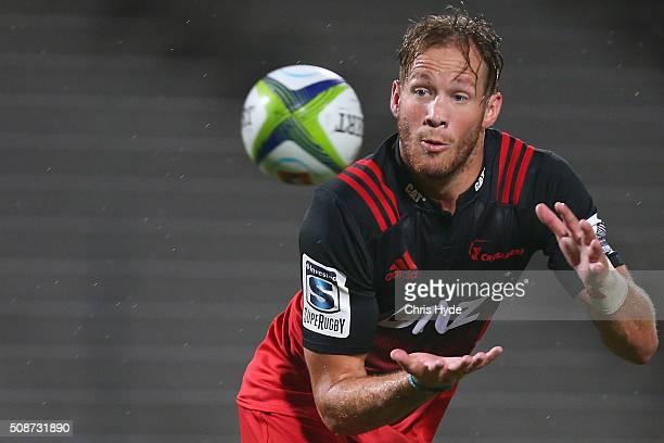 Marty McKenzie of Crusaders catches the ball during the Super Rugby preseason match between the Reds and the Crusaders at Ballymore Stadium on...