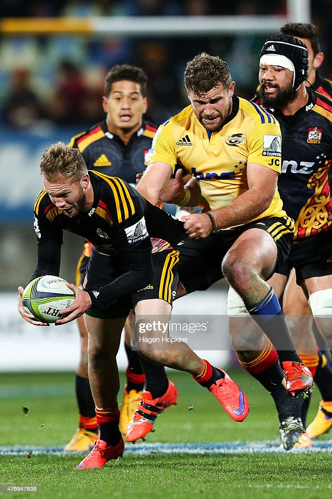 Marty McKenzie of the Chiefs is tackled by Callum Gibbins of the Hurricanes during the round 18 Super Rugby match between the Chiefs and the Hurricanes at Yarrow Stadium on June 13, 2015 in New Plymouth, New Zealand.