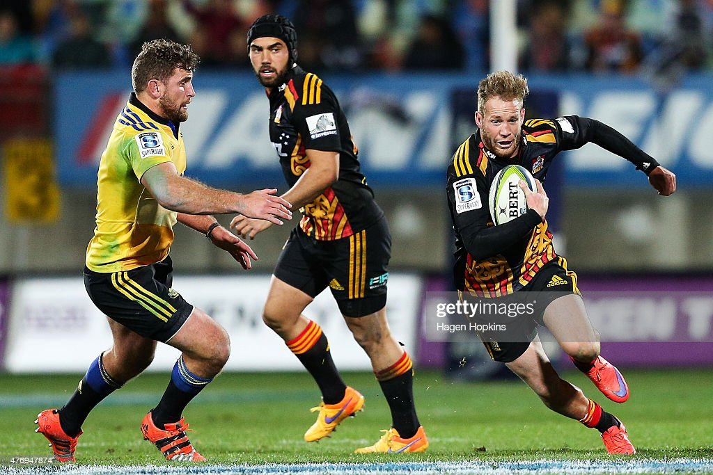 Marty McKenzie of the Chiefs makes a break from Callum Gibbins of the Hurricanes during the round 18 Super Rugby match between the Chiefs and the Hurricanes at Yarrow Stadium on June 13, 2015 in New Plymouth, New Zealand.