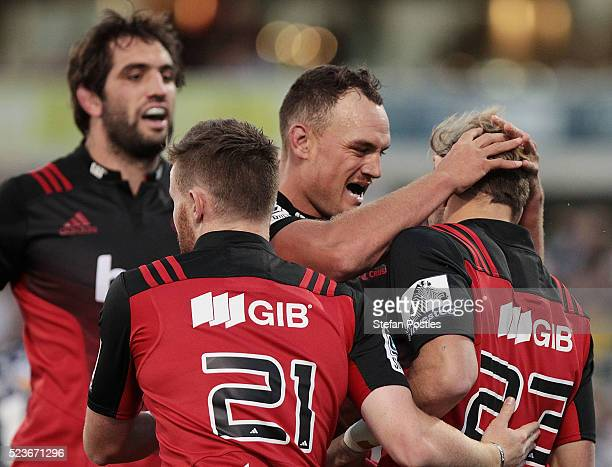 Marty McKenzie of the Crusaders is congratulated by Israel Dagg of the Crusaders after scoring a try during the round nine Super Rugby match between...