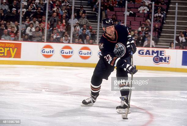 Marty McSorley of the Edmonton Oilers passes the puck during an NHL game against the New Jersey Devils on October 17 1998 at the Continental Airlines...