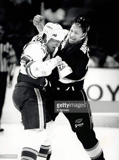 Marty McSorley of the Los Angeles Kings fights Tim Hunter of the Calgary Flames circa 1993 at the Olympic Saddledome in Calgary, Alberta, Canada.