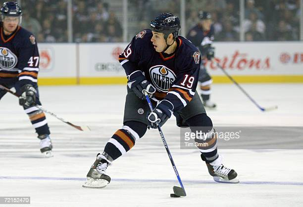 Marty Reasoner of the Edmonton Oilers skates with the puck during the season game opener against the Calgary Flames at Rexall Place on October 5 2006...