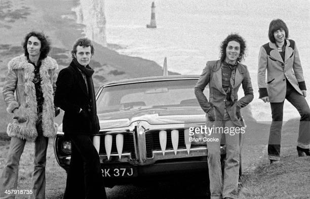 Marty Simon, Snips , Andy Fraser and Chris Spedding of Sharks photographed with The Shark Car at Beachy Head on February 7th 1973.