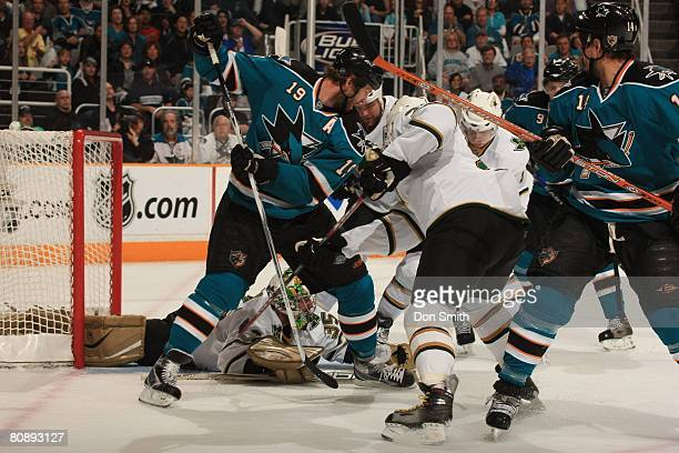 Marty Turco of the Dallas Stars makes a diving save on Joe Thornton of the San Jose Sharks during game one of the 2008 NHL Stanley Cup Playoffs...