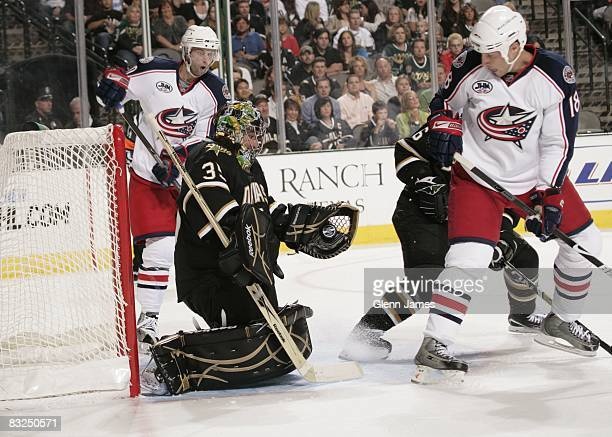 Marty Turco of the Dallas Stars makes a glove save against R.J. Umberger of the Columbus Blue Jackets on October 10, 2008 at the American Airlines...