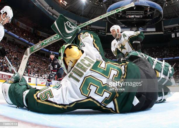 Marty Turco of the Dallas Stars makes a save off the shot of Henrik Sedin of the Vancouver Canucks during their NHL playoff game at General Motors...