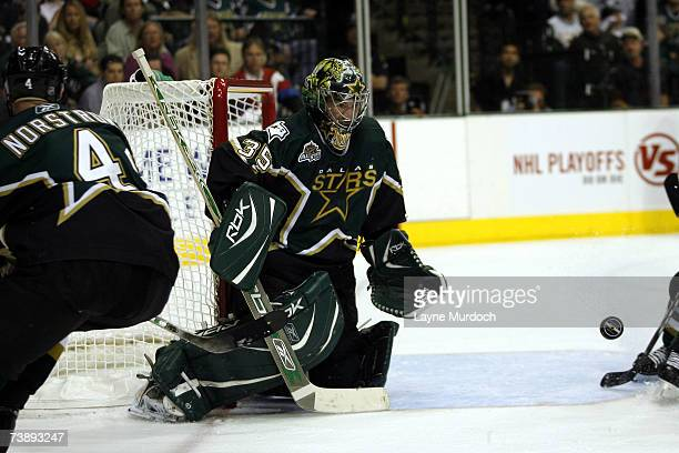 Marty Turco of the Dallas Stars makes a save on the puck against the Vancouver Canucks during the 2nd period of game three of the 2007 NHL Western...