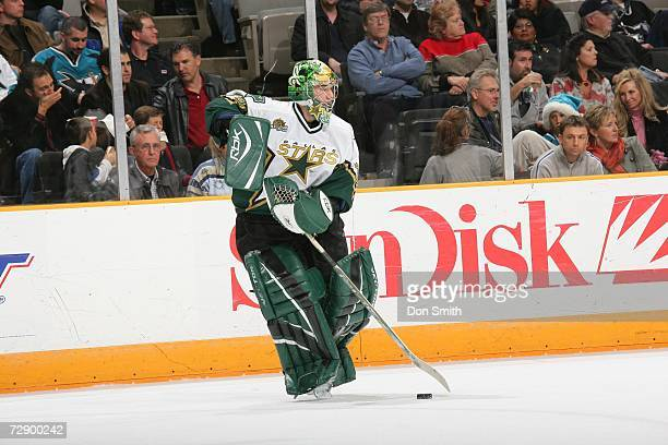 Marty Turco of the Dallas Stars plays the puck during a game against the San Jose Sharks on December 21 2006 at the HP Pavilion in San Jose...