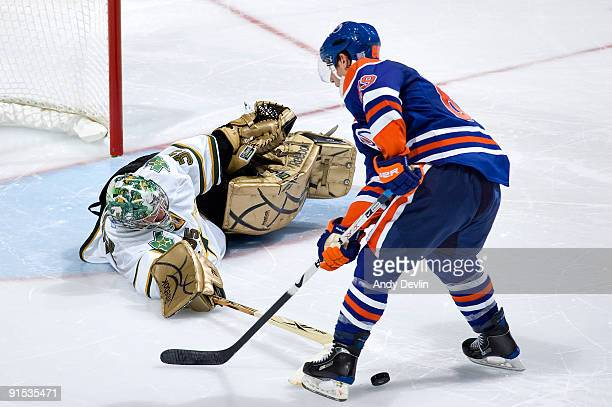 Marty Turco of the Dallas Stars pokechecks Sam Gagner of the Edmonton Oilers during the shoot-out on October 6, 2009 at Rexall Place in Edmonton,...