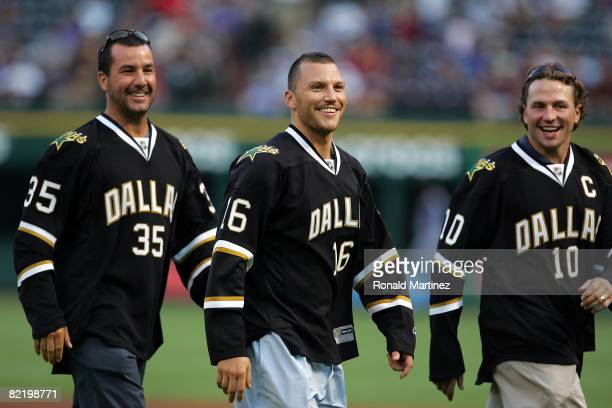 Marty Turco Sean Avery and Brenden Morow of the Dallas Stars before a game between the New York Yankees and the Texas Rangers on August 6 2008 at...