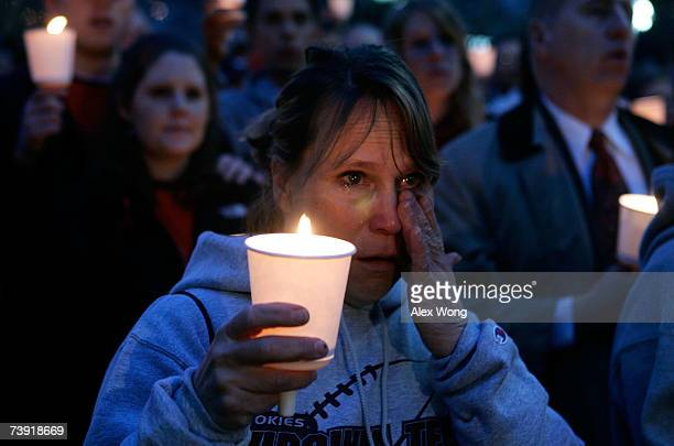 Marty Van Hook of Woodbridge Virginia whose son is a senior at Virginia Tech wipes tears during a candlelight vigil to memory the victims of the...