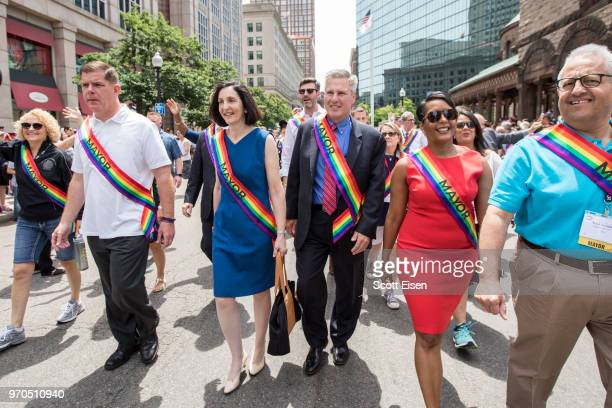 Marty Walsh mayor of Boston left marches alongside dozens of mayors from around the country during the 2018 Boston Pride Parade on June 9 2018 in...