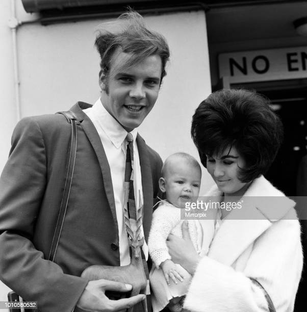 Marty Wilde at London Airport with his wife Joyce and their six month old daughter Kim after his tour in South Africa 21st April 1961