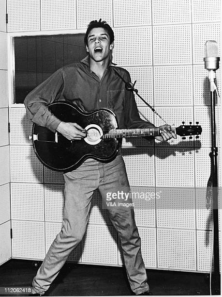 Marty Wilde playing guitar and singing in recording studio 1957