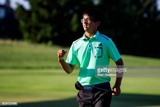 Marty Zecheng Dou celebrates on the 18th hole after winning the Digital Ally Open of the WEBCOM Tour at Nicklaus Golf Club at Lionsgate on July 30...