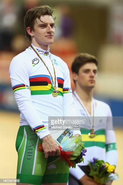 Martyn Irvine of Ireland celebrates on the winners podium after claiming gold alongside Luke Davison of Australia who claimed bronze in the men's...
