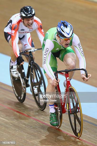 Martyn Irvine of Ireland crosses the finishing line from Andreas Mueller of Austria to win gold in the men's scratch race final during day two of the...