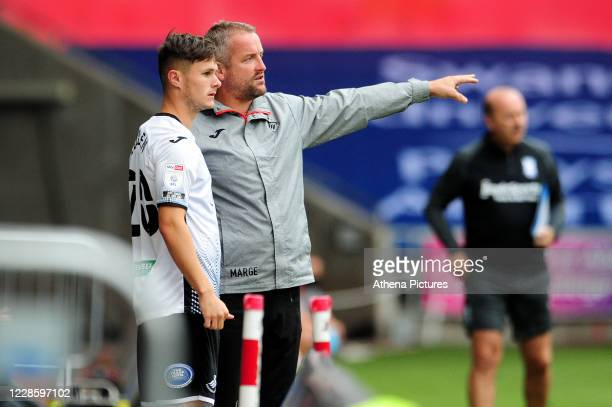 Martyn Margetson goalkeeping and set piece coach for Swansea City speaks with Liam Cullen of Swansea City during the Sky Bet Championship match...
