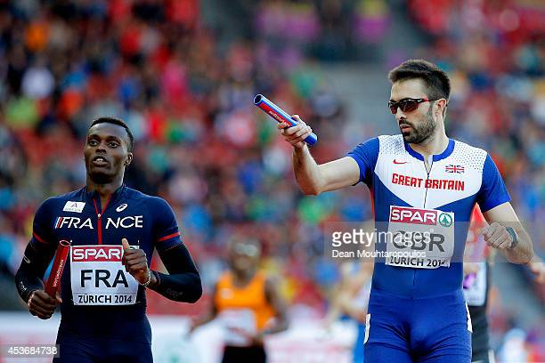 Martyn Rooney of Great Britain and Northern Ireland celebrates as Thomas Jordier of France looks on in the Men's 4x400 metres relay heats during day...